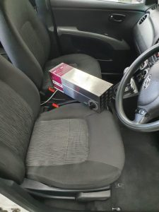 photo of a vehicle interior with an ozone generator in it
